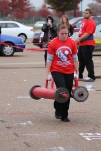 Kristyn Vytlacil Whisman Strongwoman doing the Farmer Walk